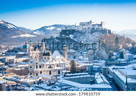 Beautiful view of the historic city of Salzburg with Festung Hohensalzburg in winter, Salzburger Land, Austria - stock photo