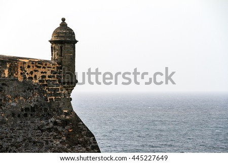 Beautiful view of the large outer wall with sentry box of fort San Cristobal in San Juan, Puerto Rico - stock photo
