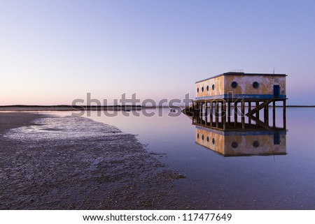 Beautiful view of the life saver house located in the village of Fuseta, Portugal. - stock photo