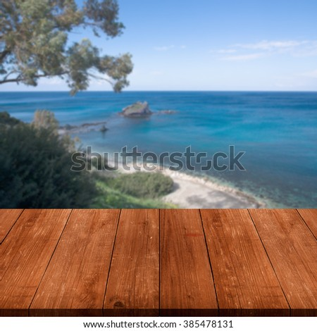 Beautiful view of the Mediterranean Sea over old dark wooden table or board. Collage. Selective Focus. - stock photo