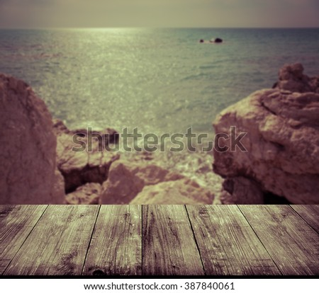 Beautiful view of the Mediterranean Sea over old light wooden table or board. Collage. Selective Focus. Toned. - stock photo