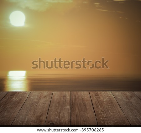 Beautiful view of the Mediterranean Sea over old wooden table or board. Collage. Selective Focus. Toned. - stock photo