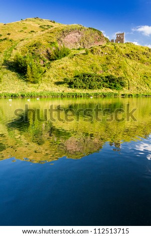 Beautiful view of the mountains and a lake in summer - stock photo