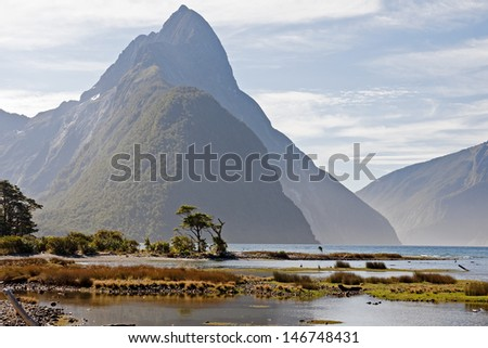 Beautiful view of the mountains from the port of Mildford Sound - stock photo