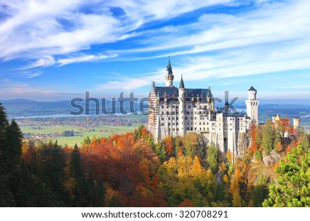 Beautiful view of the Neuschwanstein castle in autumn   Neuschwanstein is a palace in Bavaria, Germany. Today Neuschwanstein is one of the most popular of all the palaces and castles in Europe.  - stock photo