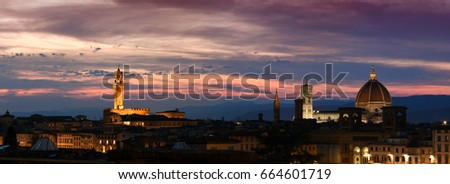 Beautiful view of the Old Palace, Giotto's Bell Tower and the Cathedral of Santa Maria del Fiore in Florence at sunset. Italy.
