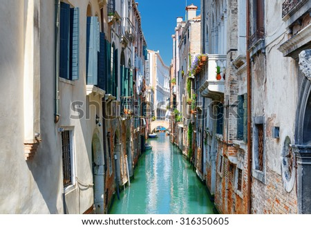 Beautiful view of the Ponte Del Ravano and the Rio de S. Maria Mater Domini Canal from the Ponte S. Maria Mater Domini in Venice, Italy. Venice is a popular tourist destination of Europe. - stock photo