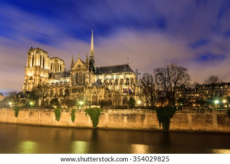 Beautiful view of the river Seine with the Notre-Dame Cathedral in Paris at night - stock photo