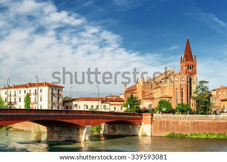 Beautiful view of the Saints Fermo and Rustico church from the Adige River in Verona, Italy. Verona is a popular tourist destination of Europe. - stock photo