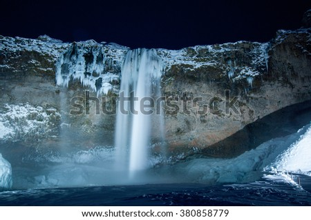 Beautiful view of the Seljalandsfoss waterfall in Iceland in winter at night.