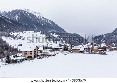 Beautiful view of the small town Bergun and the alps including Piz Ela from the sightseeing train Glacier Express in winter Canton of Grisons, Switzerland