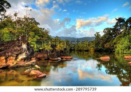 Beautiful view of the tropical jungle river at the beach of Masoala National Park in Madagascar - stock photo