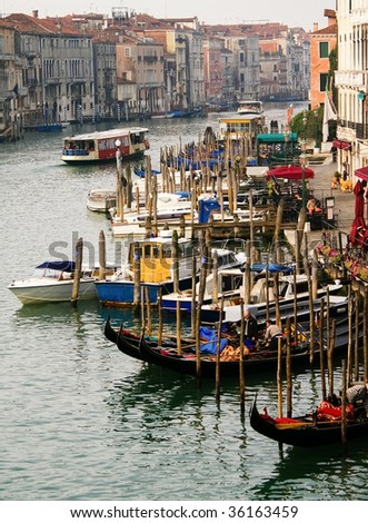 Beautiful view of the water street, Grand canal and the traditional gondola in Venice, Italy, from a bridge - stock photo
