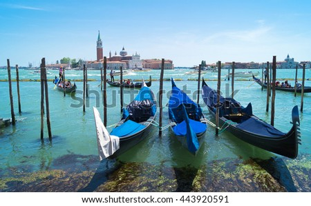 Beautiful view of traditional Gondolas moored on piazza San Marco with historic Basilica of San Giorgio Maggiore  in the background - Venice, Venezia, Italy, Europe - stock photo