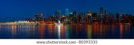 Beautiful view of Vancouver's city skyline during a blue hour - British Columbia, Canada. - stock photo