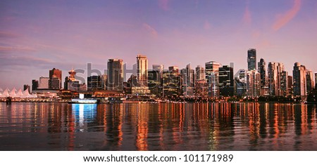 Beautiful view of Vancouver skyline at sunset as seen from Stanley Park, BC, Canada - stock photo