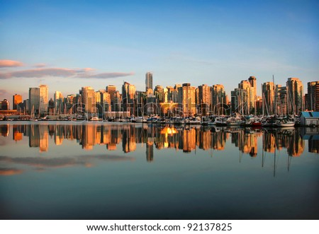 Beautiful view of Vancouver skyline with harbor at sunset, British Columbia, Canada - stock photo