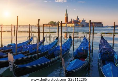Beautiful view of Venice with gondolas at sunrise, Italy - stock photo