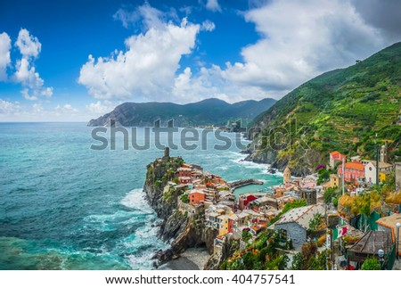 Beautiful view of Vernazza, one of the five famous fisherman villages of Cinque Terre with blue sky and a dramatic cloudscape on a sunny day in summer, Liguria, Italy - stock photo