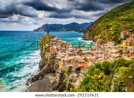 Beautiful view of Vernazza, one of the five famous fisherman villages of Cinque Terre with dark dramatic cloudscape in Liguria, Italy - stock photo