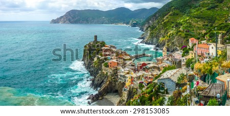 Beautiful view of Vernazza, one of the five famous fisherman villages of Cinque Terre with dramatic cloudscape in Liguria, Italy - stock photo