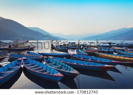 beautiful view of wooden boats in Phewa lake, Pokhara, Nepal - stock photo