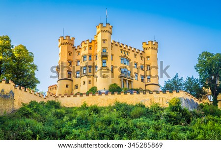 Beautiful view of world-famous Hohenschwangau Castle, the 19th century historic childhood residence of King Ludwig II of Bavaria, in beautiful evening light at sunset, Fussen, Bavaria, Germany - stock photo