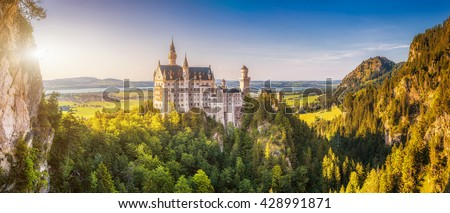 Beautiful view of world-famous Neuschwanstein Castle, the 19th century Romanesque Revival palace built for King Ludwig II, in beautiful evening light at sunset, Fussen, southwest Bavaria, Germany - stock photo