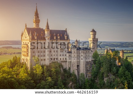 Beautiful view of world-famous Neuschwanstein Castle, the 19th century Romanesque Revival palace built for King Ludwig II, in golden evening light at sunset, Fussen, southwest Bavaria, Germany