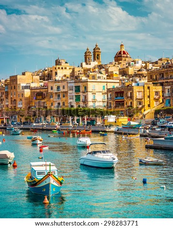 beautiful view on Birgu and the harbour with colorful boats in Malta - stock photo