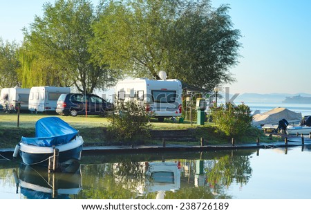 Beautiful view on camping site in the morning light. Italy - stock photo