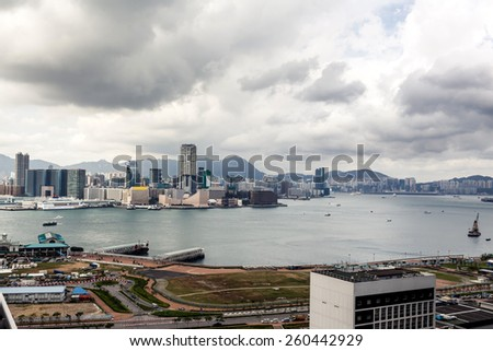 Beautiful view on Hong Kong city buildings and river with yacht with cloudy sky on background - stock photo