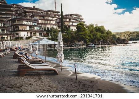 Beautiful view on luxury resort at sea beach at sunrise - stock photo