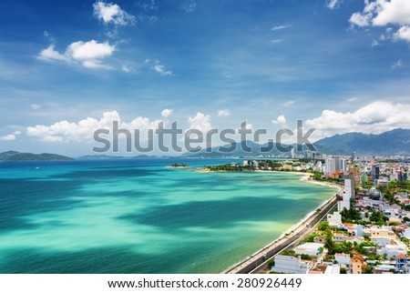 Beautiful view on Nha Trang and Nha Trang Bay of South China Sea with magic colors of water on blue sky background in Khanh Hoa province, Vietnam. Nha Trang is a popular tourist destination of Asia. - stock photo