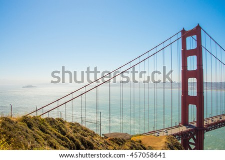 Beautiful view on one part of the Golden Gate bridge in San Francisco with a bay behind it.