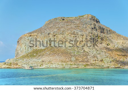 Beautiful view on pirate island of Imeri Gramvousa and venetian castle on a mountain, near with Crete island.District of Chania.Seascape.Greece.Europe. - stock photo