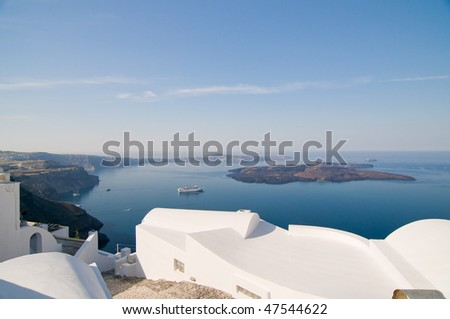 Beautiful view on Santorini volcano, blue see and sky