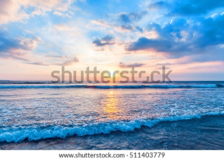 Beautiful view on sea with coming surf waves unsed sunset sky