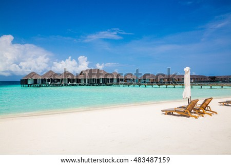 Beautiful view on the water villas and bungalow from the beach
