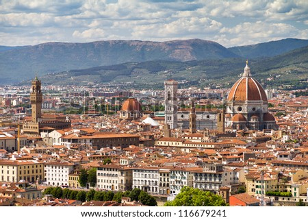 Beautiful view over the city of Florence, Italy, with the Cathedral and the Palazzo Vecchio - stock photo