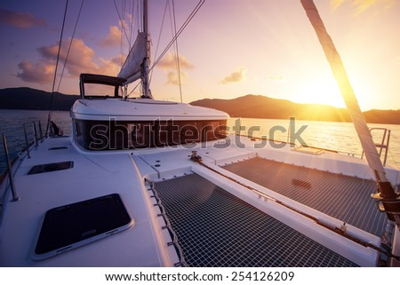Beautiful view to catamaran in Seychelles bay at sunset - stock photo