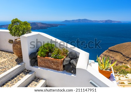 Beautiful View To The Mediterranean Sea Over The White Walls of Fira In Santorini, Greece
