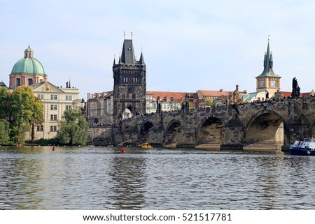 Beautiful view with Famous Charles Bridge, tower and Vltava river, Prague, Czech Republic.