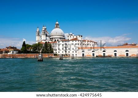 Beautiful view with historic Basilica di Santa Maria della Salute on a sunny day in Venice, Italy - stock photo