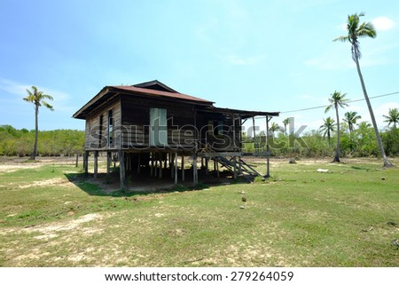 Beautiful view with old hut in the middle and the coconut tree at Sabah, East Malaysia, Borneo. (Shallow DOF, slight motion blur) - stock photo