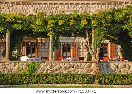 Beautiful view with outdoor restaurant terrace (Italy) - stock photo