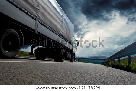 Beautiful view with truckcar on the road  under sky with clouds - stock photo