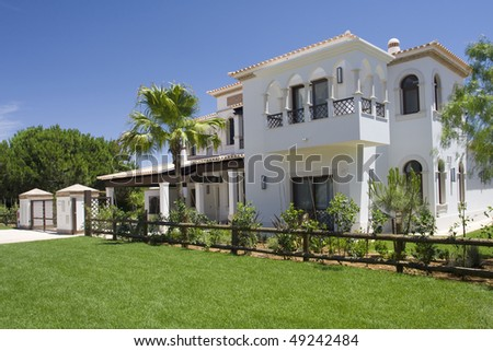 Beautiful villa with a healthy garden at Algarve on a sunny day, south of Portugal - stock photo