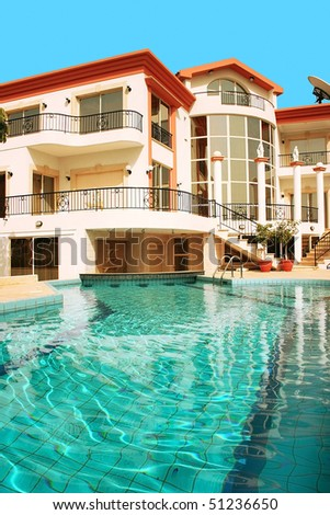 Beautiful villa with columns and swimming pool. - stock photo