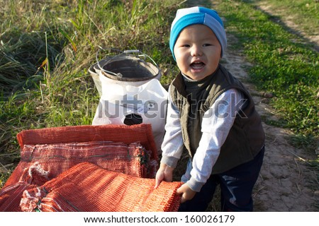 beautiful village boy, playing, smiling and showing